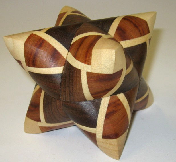 File:Dual Tetrahedron 9 maple plum walnut.jpeg